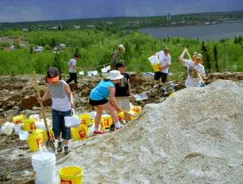 McIsaac School Students Help to Spread Limestone